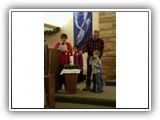 Roger and Sally Brelsford, with their grandchildren Raelyn and Jesse, light the Advent Candles