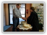 Pastor Lesley washes hands and blesses everyone as they enter for the Seder meal on Maundy Thursday.